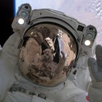 Discovery astronaut Stephen K Robinson is relfected in his colleague Soichi Noguchi's helmet during the Return to Flight mission in 2005. It was NASA's first shuttle mission following the Columbia disaster of 2003. Columbia broke apart while returning to Earth, just minutes from landing, with the loss of all seven crew. (Image: NASA)