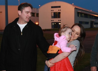 Ellie Madden and her parents after the toddler spent five months in Boston.