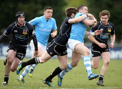 Ronan O'Mahony of Garryowen is tackled by Ballymena's Mark Irwin.