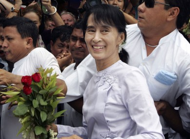 Aung San Suu Kyi arrives at her party headquarters this morning