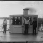 On the deckhouse of the steamboat Sheksna of the MPS, 1909. The photographer with two men, Murman, 1915. (Library of Congress, Prints & Photographs Division)