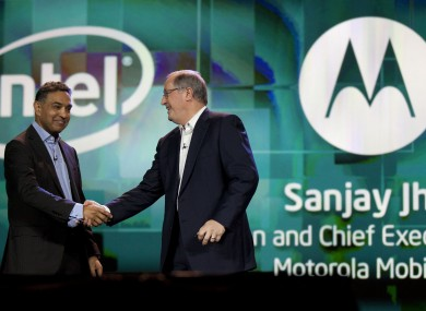 Sanjay Jha, chairman and CEO of Motorola Mobility, left, is greeted by Intel president and CEO Paul Otellini at 2012 International Consumer Electronics Show