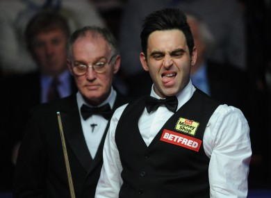 Ronnie O'Sullivan sizes up his next shot.