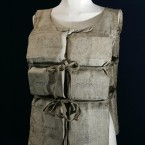 A Titanic life-preserver, belong to a survivor, which was auctioned at Christie's Maritime sale in 2007. The century-old canvas jacket, lined with buoyant cork, belonged to Mabel Francatelli, one of 12 passengers to escape from the RMS Titanic in a lifeboat built to fit 40, the London-based auction house said. Her vest - carrying her faded signature and those of seven other survivors - was offered for sale along with a letter she wrote describing what happened that night. (AP Photo/Sang Tan)