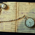 A mariner's certificate of discharge from the White Star Liner RMS Titanic which sunk in 1912 and a silver chain watch at Bonhams auction house. The items will go under the hammer later this month. (Michael Stephens/PA Images)