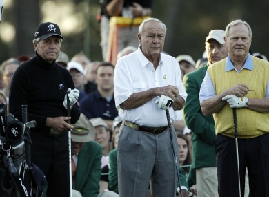 Honorary players Gary Player, Arnold Palmer and Jack Nicklaus wait to tee off on the first hole..