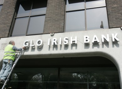 The sign is removed from the former Anglo HQ last year