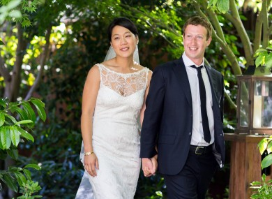 This photo provided by Facebook shows Facebook founder and CEO Mark Zuckerberg and Priscilla Chan at their wedding ceremony in Palo Alto, Calif., Saturday, May 19, 2012