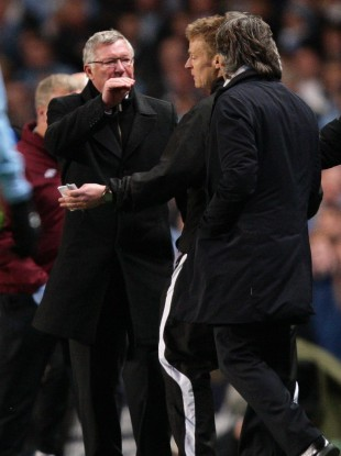 Fergie and Mancini are separated by fourth official Mike Jones.