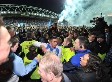 Huddersfield celebrate their promotion to League One.
