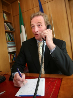 Enda Kenny on the phone (File photo)