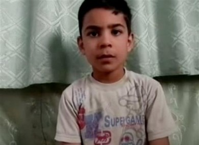 This image made from amateur video, released by the Houla Media Office and accessed Thursday, May 31, 2012 purports to show 11-year-old Ali el-Sayed, a survivor of the Houla massacre that began Friday and left 108 people dead, many of them children and women.
