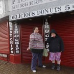 Two ladies are seen smoking outside their place of work early in the morning in Blackpool.  Image: Eddie Keogh
