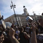 People banging on saucepans with spoons shout slogans during a gathering marking the one year anniversary of Spain's Indignados (Indignant) movement in Madrid's Puerta del Sol May 15, 2012. Dubbed