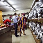 The tailor takes a measure of a new summer uniform for a Swiss guard in Vatican City.   Image: Stefano Dal Pozzolo