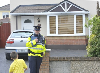 A Garda outside the house where the body of the woman was discovered this morning.