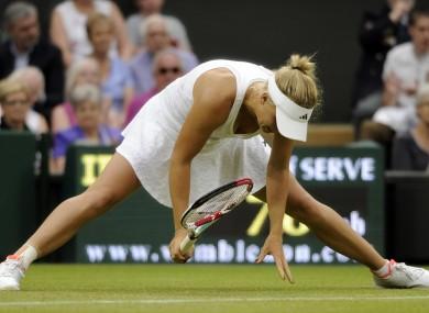 Caroline Wozniacki is beaten on Centre Court yesterday.