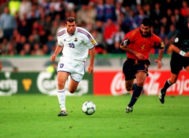 Zinedine Zidane takes the ball away from Spain's Josep Guardiola.
