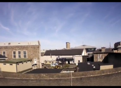 The drone peers over the wall of the Mountjoy Prison complex