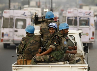 In this Jan. 10, 2011 file photo, United Nations soldiers from Niger conduct a patrol through the streets of Abidjan, Ivory Coast.