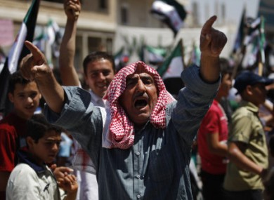 A Syrian man chants slogans during an anti-Bashar Assad protest after Friday prayers on the outskirts of Idlib.