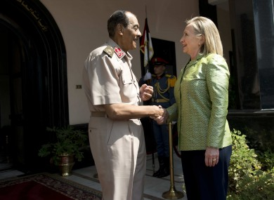 Field Marshal Hussein Tantawi, left, greets US Secretary of State Hillary Rodham Clinton before a meeting at the Ministry of Defense