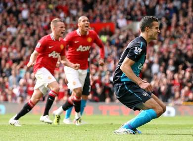 Van Persie reacts to his penalty miss against United last season.