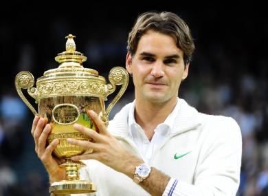 Roger Federer cradles his seventh Wimbledon title.
