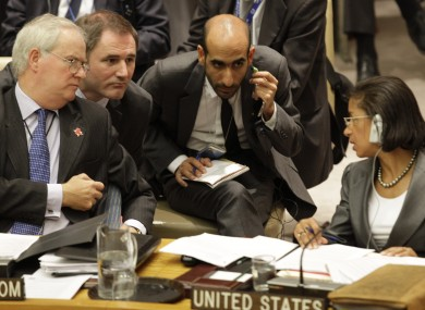 Britain's UN ambassador Mark Lyall Grant speaks with