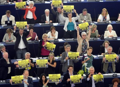 Green Party members of the European parliament demonstrate against the ACTA project during the vote