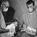 This is an astonishing picture when you realise the context - it shows two US army medics holding a pair of newborn Vietnamese  conjoined twins who were separated in a two-hour operation at the US Army Evacuation Hospital in Vung Tau, south Vietnam at the height of the Vietnam War in 1969. Twins Shirley and Judy had been joined at the abdomen and liver. (Pic: AP Photo/Max Nash)