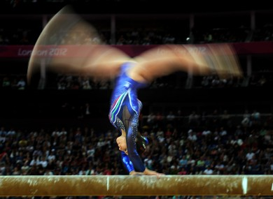 Italy's Vanessa Ferrari competes on the beam during the Artistic Gymnastics team qualification.