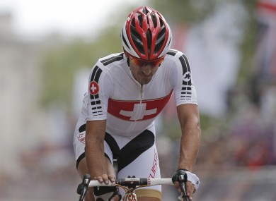 Switzerland's Fabian Cancellara crosses the finish line after completing the Men's Road Cycling on Saturday.