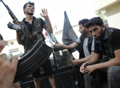 Syrian rebels sit in a pick up truck in Aleppo, Syria yesterday.