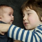 These are indeed 'twins'. Reuben Blake, 5, with his twin Floren, seven weeks, in Cheltenham, Englan in January this year - they were conceived from the same batch of embryos created during their parents' fertility treatment but implanted five years apart. (Pic: Ben Birchall/PA Wire)