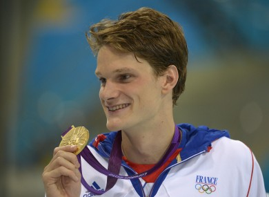 Agnel poses with his medal for the men's 200-meter freestyle.