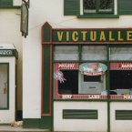 Photo: felix o Flickr/CreativeCommons  This photo from 1989 shows a phone box painted in the unusual colours of green and white to match the butcher's shop.