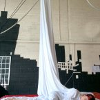 Sculpting with the silks – silks are an endlessly inspiring piece of equipment that can be a cradle, a shroud, a screen for projection – or, you know, a bed when you need some zzzz… Image: Ether crew/Niamh Creely.