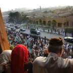 Egyptians greet a convoy carrying President Mohammed Morsi as he leaves following the feast prayers at Amr Ibn Al-As mosque in Cairo today. (AP Photo/Amr Nabil/PA)