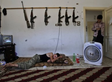 A Syrian rebel sleeps at a rebel HQ in the outskirts of Aleppo.