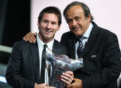 Messi, with UEFA president Michel Platin