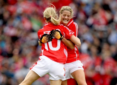 Cork's Nollaig Cleary (L) celebrates scoring the opening goal with Juliet Murphy.