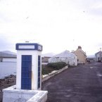 Photo: sludgegulper Flickr/CreativeCommons  The village street and concrete telephone box. In the background the bridge between the mainland and Valentia Island, famous resort of sea anglers.