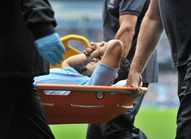 Aguero is stretchered off/
