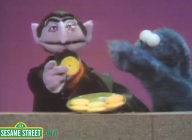 Count von Count with the Cookie Monster in Sesame Street