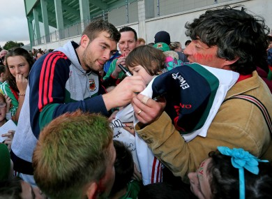 Aidan O'Shea signs autographs for Mayo fans.