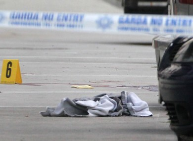 Discarded clothing and bloodstains visible at the scene of the shooting today