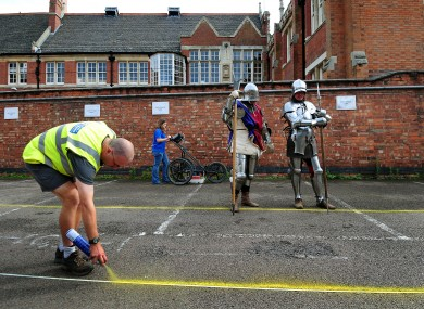 Richard III watches while archaeologists prepare to dig for him. Kidding. It's just actors dressed up.