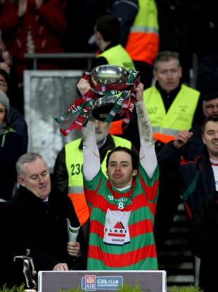 Brian Óg Maguire lifts the trophy after Lisnaskea Emmets' win in the All-Ireland IFC Club Final in 2011.