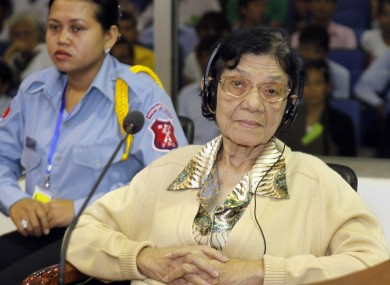 Ieng Thirith, the Khmer Rouge's former Social Affairs Minister and wife to Ieng Sary, the communist group's former Foreign Minister, looks on inside a courtroom of the UN-backed tribunal